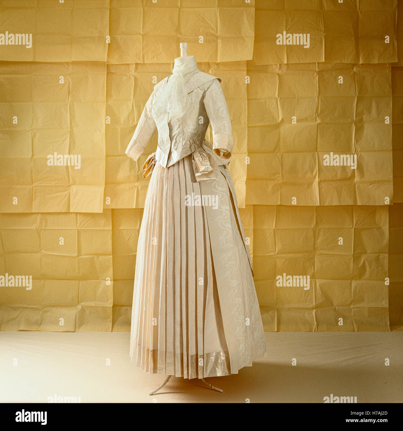 Pleated skirt with jacket, historical replica paper dress by Isabelle de Borchgrave - Stock Image