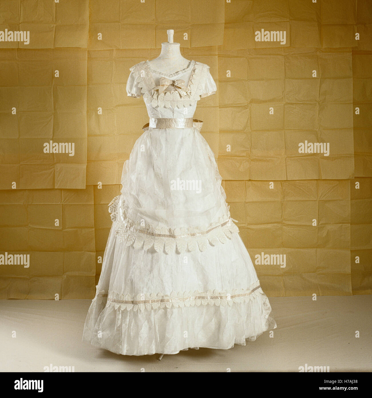 White lace short-sleeved and tiered historical replica paper dress by Isabelle de Borchgrave - Stock Image