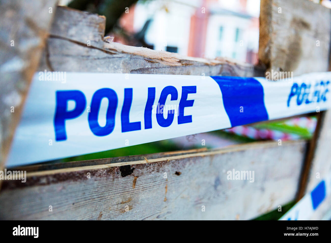 Police tape used to let people know police are aware of incident keep out police sign UK England GB - Stock Image