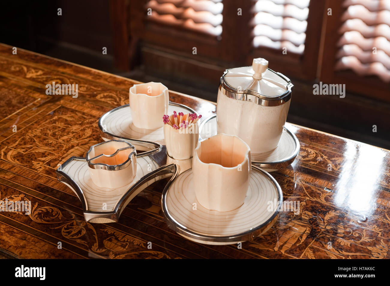 French Art Deco silver mounted ivory, club shaped smokers compendium Guinevere's antique shop on Kings Road, - Stock Image