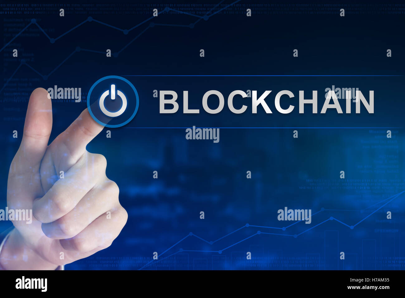 double exposure business hand clicking blockchain button with blurred background - Stock Image