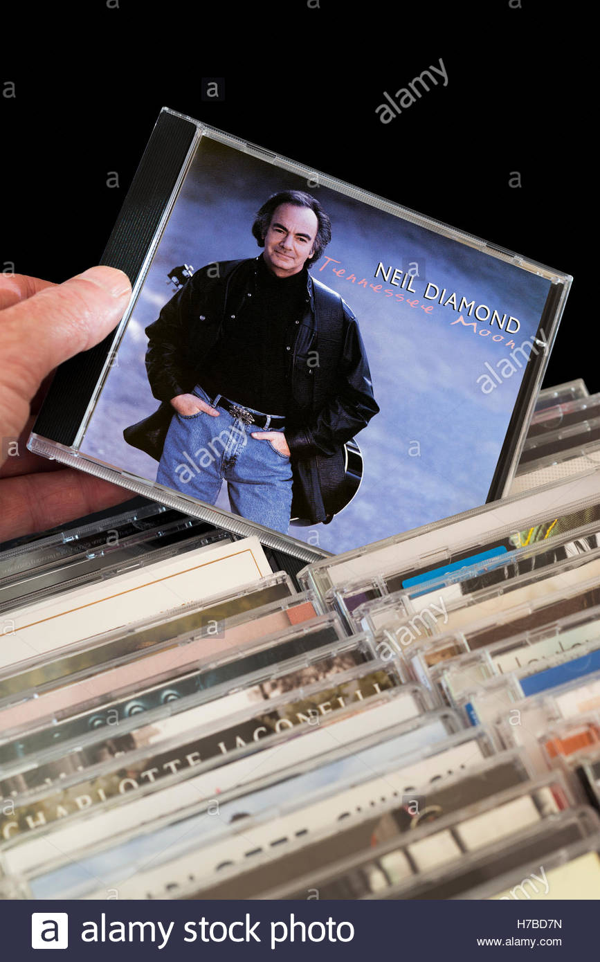 Tennessee Moon, Neil Diamond CD being chosen from among rows of other CD's Stock Photo