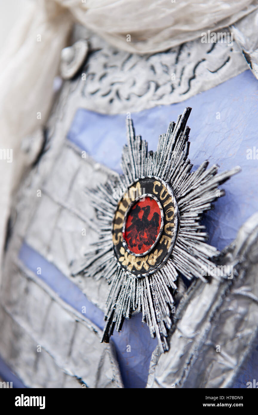 Star shaped brooch, historical replica paper accessory, by Isabelle de Borchgrave - Stock Image