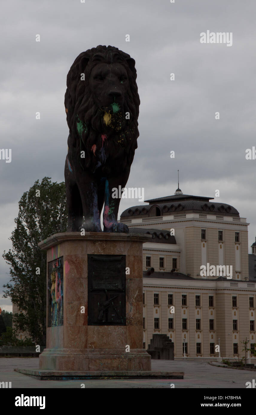 Lion statue in Skopje painted by protests - Stock Image