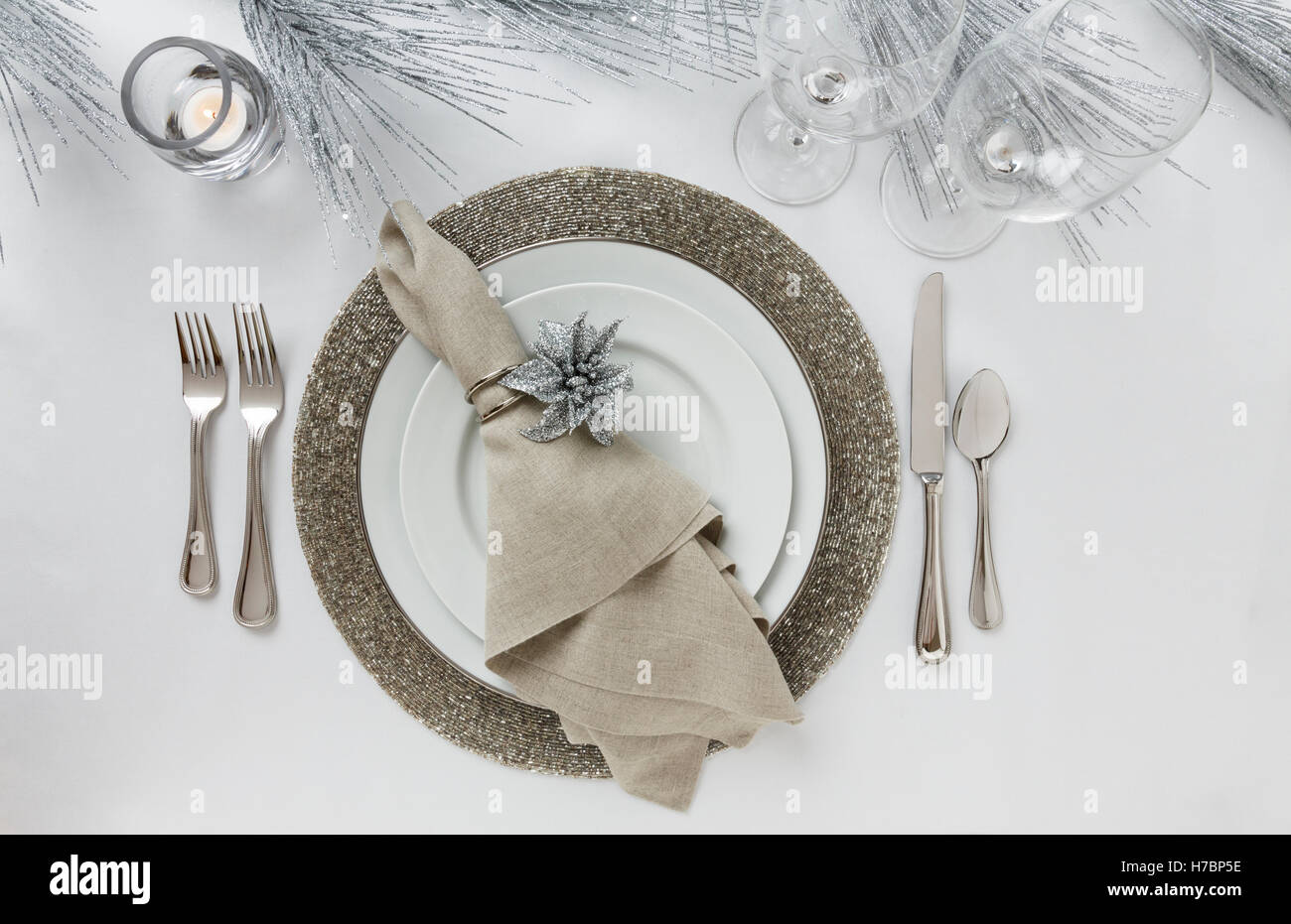 Festive fancy formal fine dining Christmas or New Year's Eve holiday dinner party table setting place setting - Stock Image