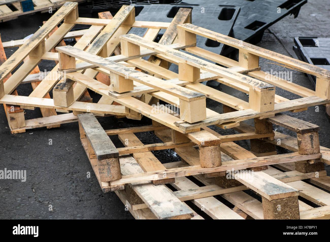 Pile of wooden crates outside on the pavement outside Smithfield Market, London, UK - Stock Image