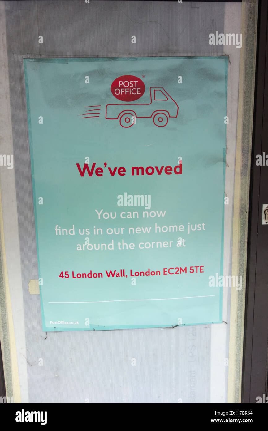 'We've Moved' sign outside a closed Post Office on Moorgate. City of London, UK - Stock Image