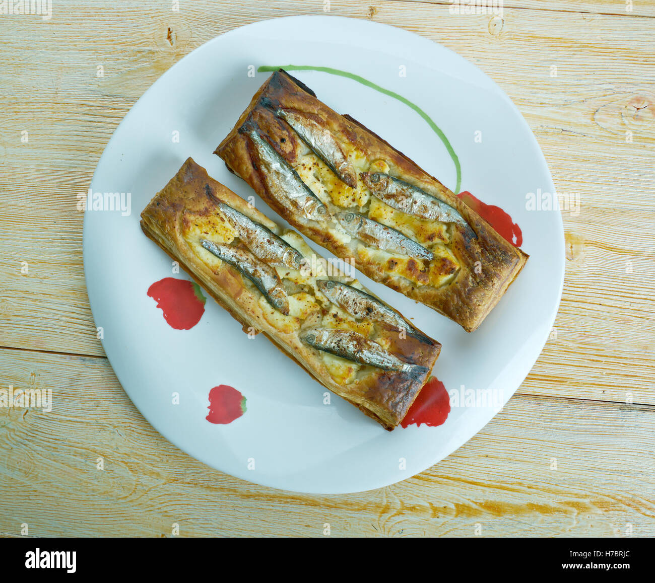 Pastry tart with anchovies. French cuisine - Stock Image