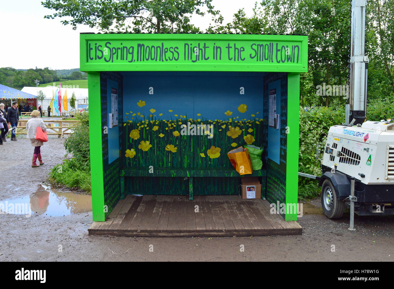 Bus shelter at the Hay Festival decorated with quote from Under Milk Wood by Dylan Thomas - Stock Image