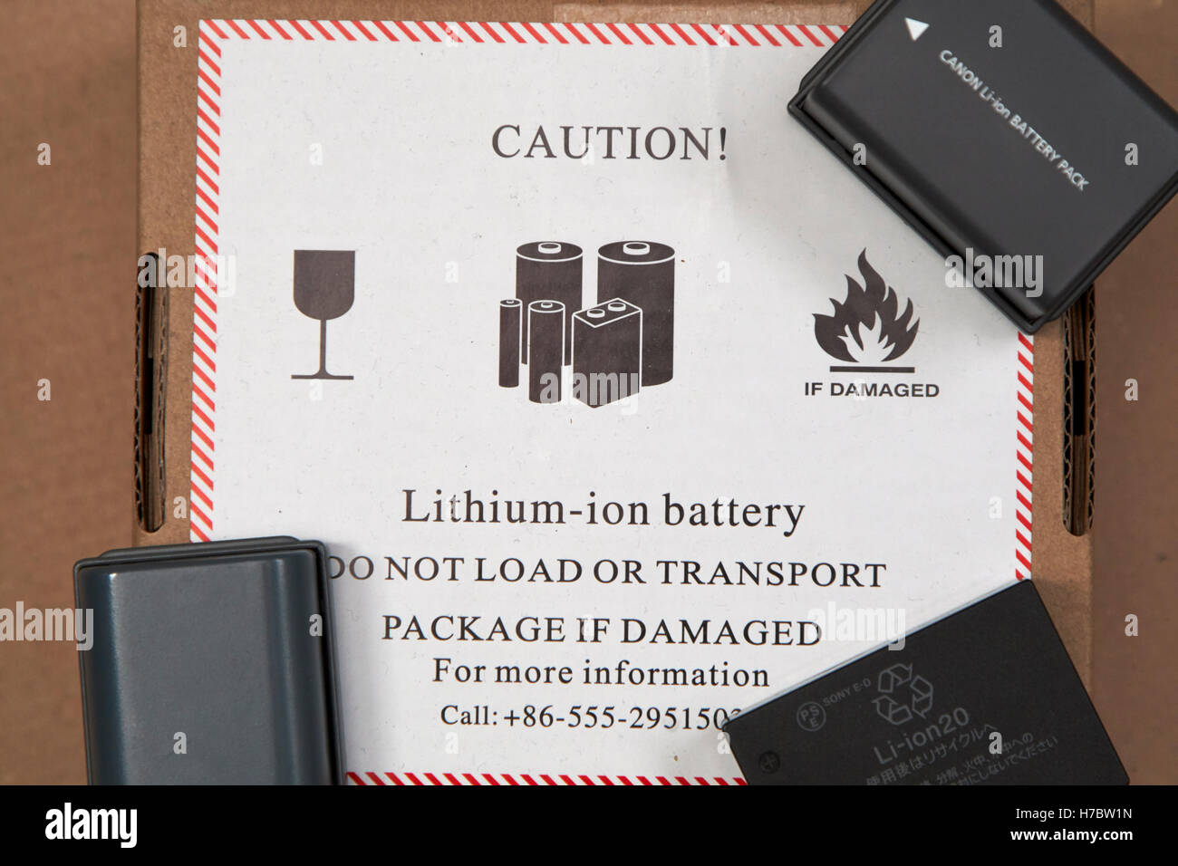 litium ion batteries sent through the post with mailer in the uk - Stock Image