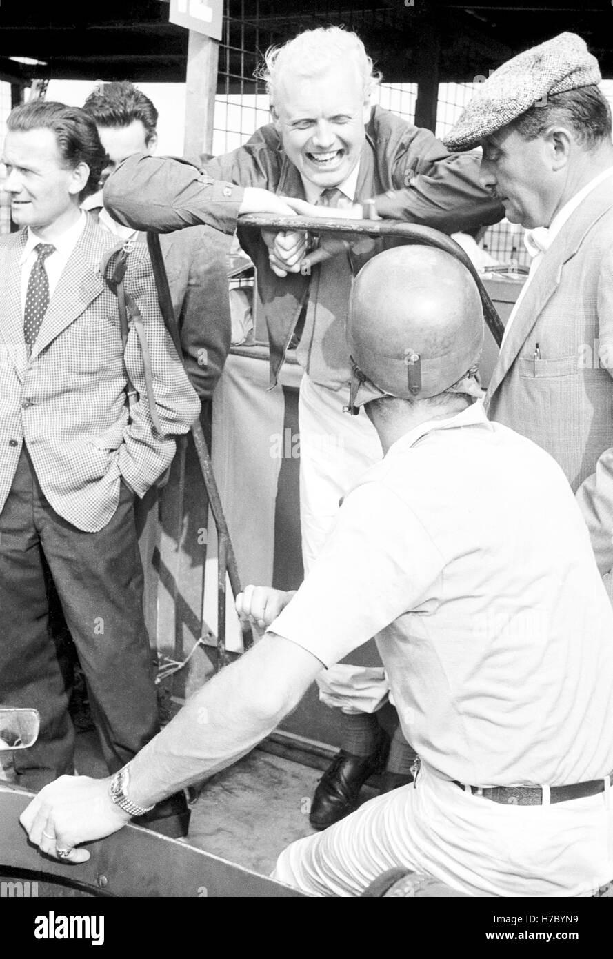 1957 Mike Hawthorn British motor racing driver Aintree pits UK - Stock Image