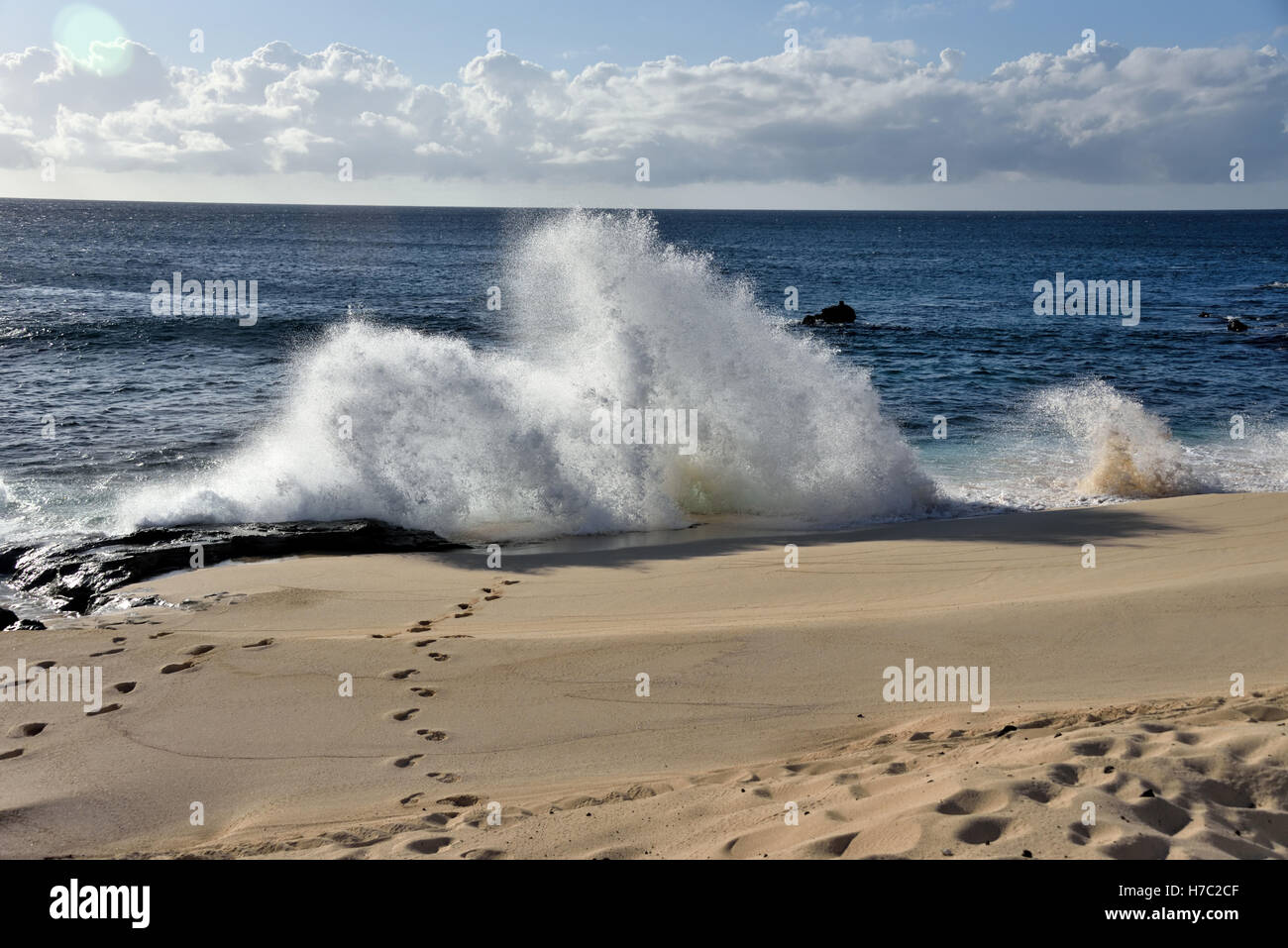 Waves breaking on Dead Man's Beach near Georgetown on Ascension Island - Stock Image