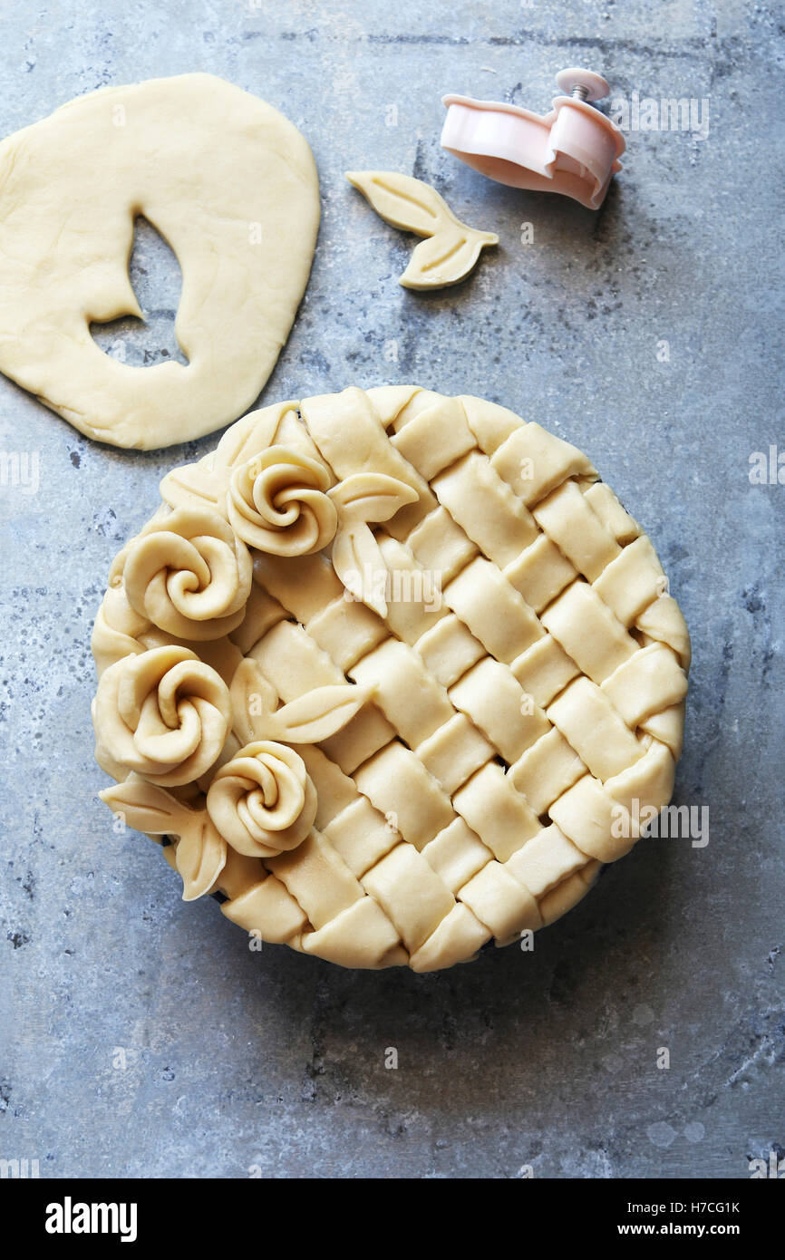 Pie crust with lattice and roses decoration.Top view. - Stock Image