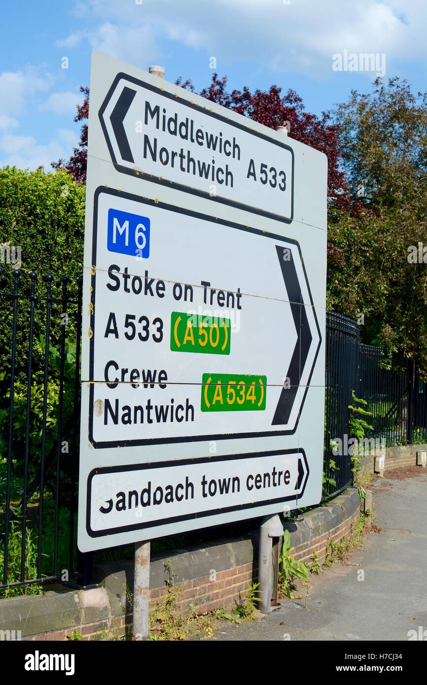 Road sign - traffic road sign showing direction to Crewe, Nantwich, Middlewich, Northwich, Stoke on Trent and Sandbach, - Stock Image
