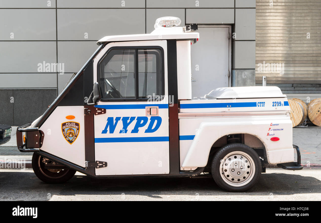 NYPD (New York Police Department) three wheeled buggy car parked on a street - Stock Image