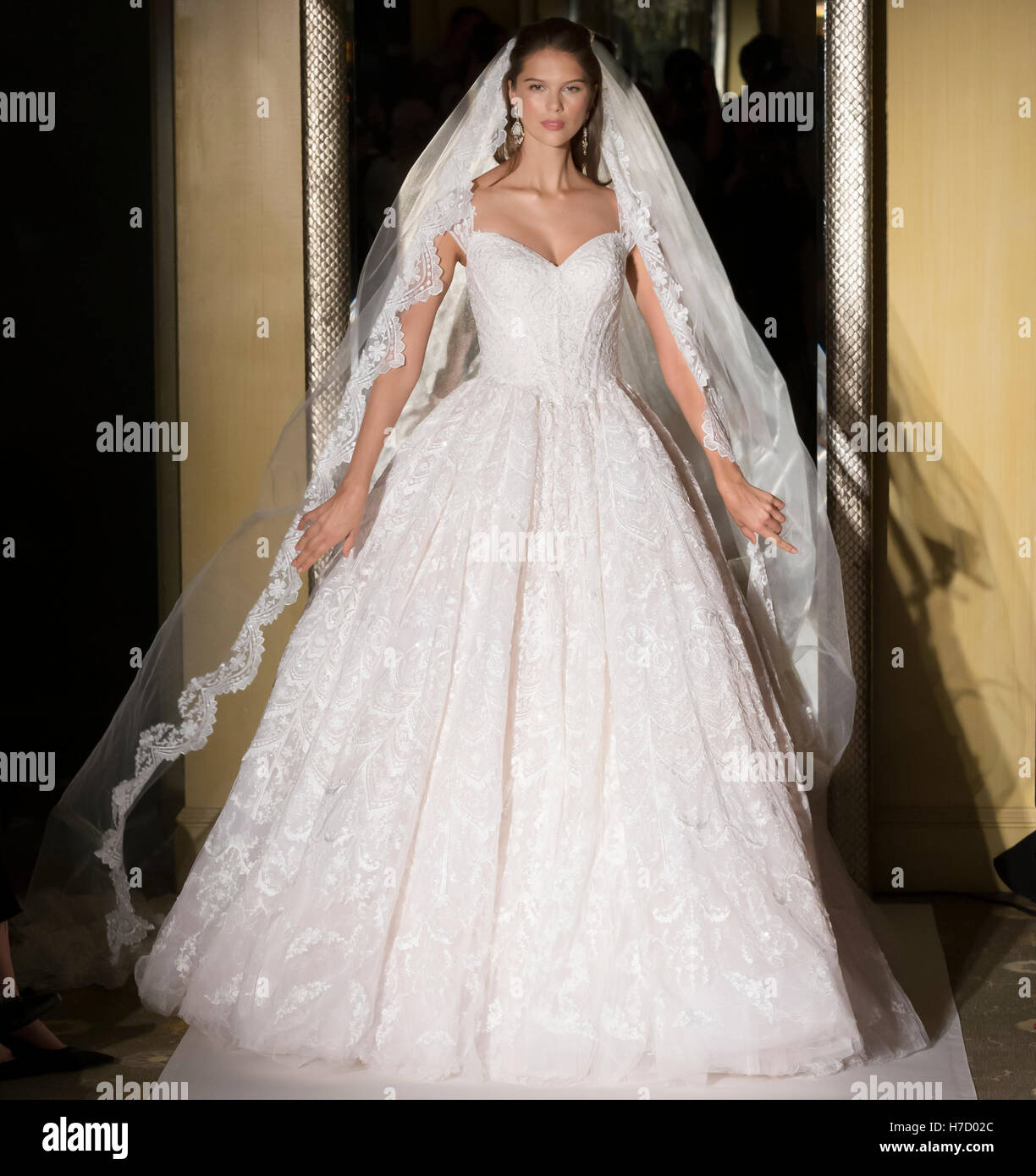 NEW YORK, NY - October 06, 2016: A model walks the runway during the Oleg Cassini Bridal Fall/Winter 2017 Runway - Stock Image