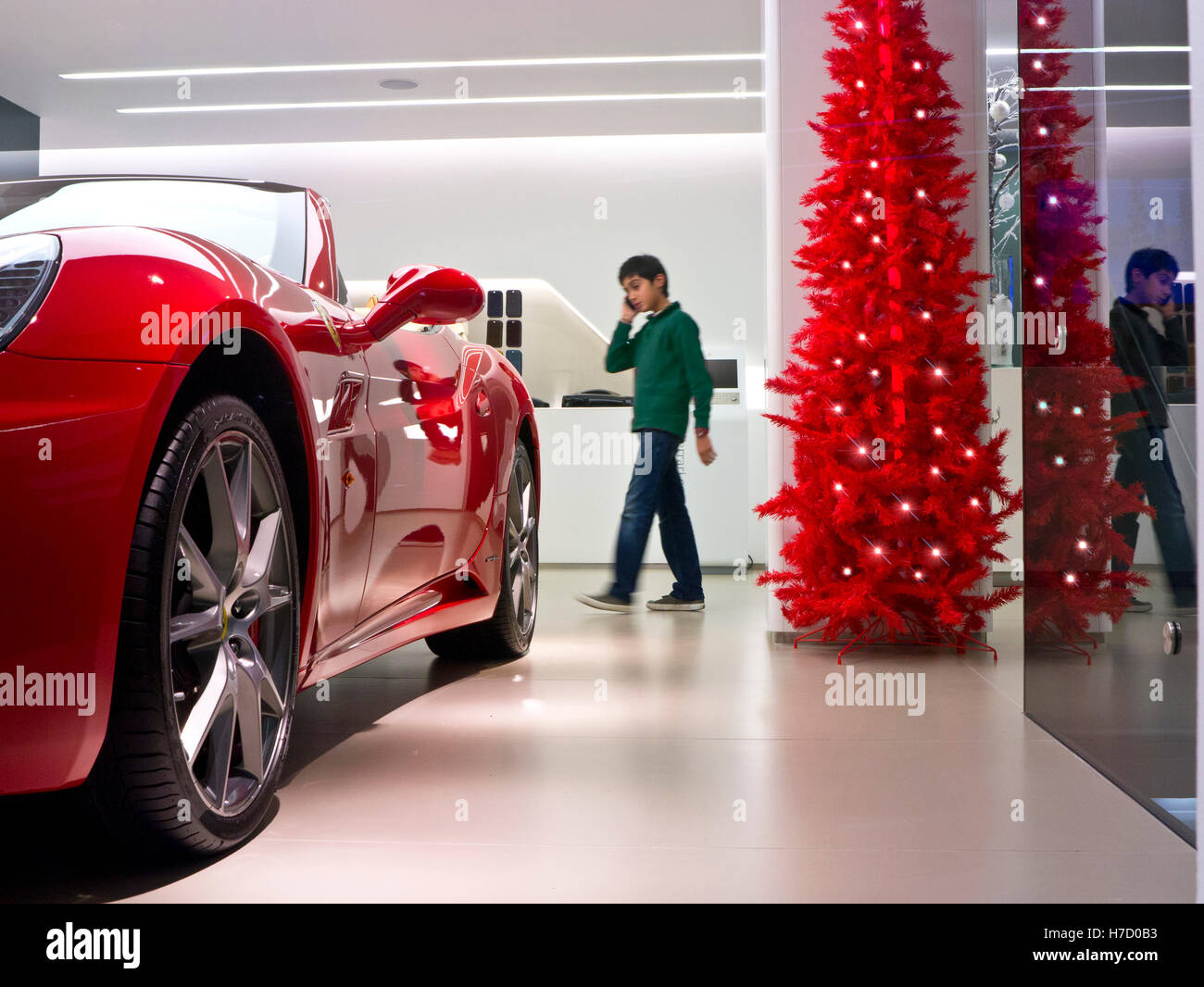 Christmas Sports Car.Red Ferrari California Sports Car On Display For Sale In