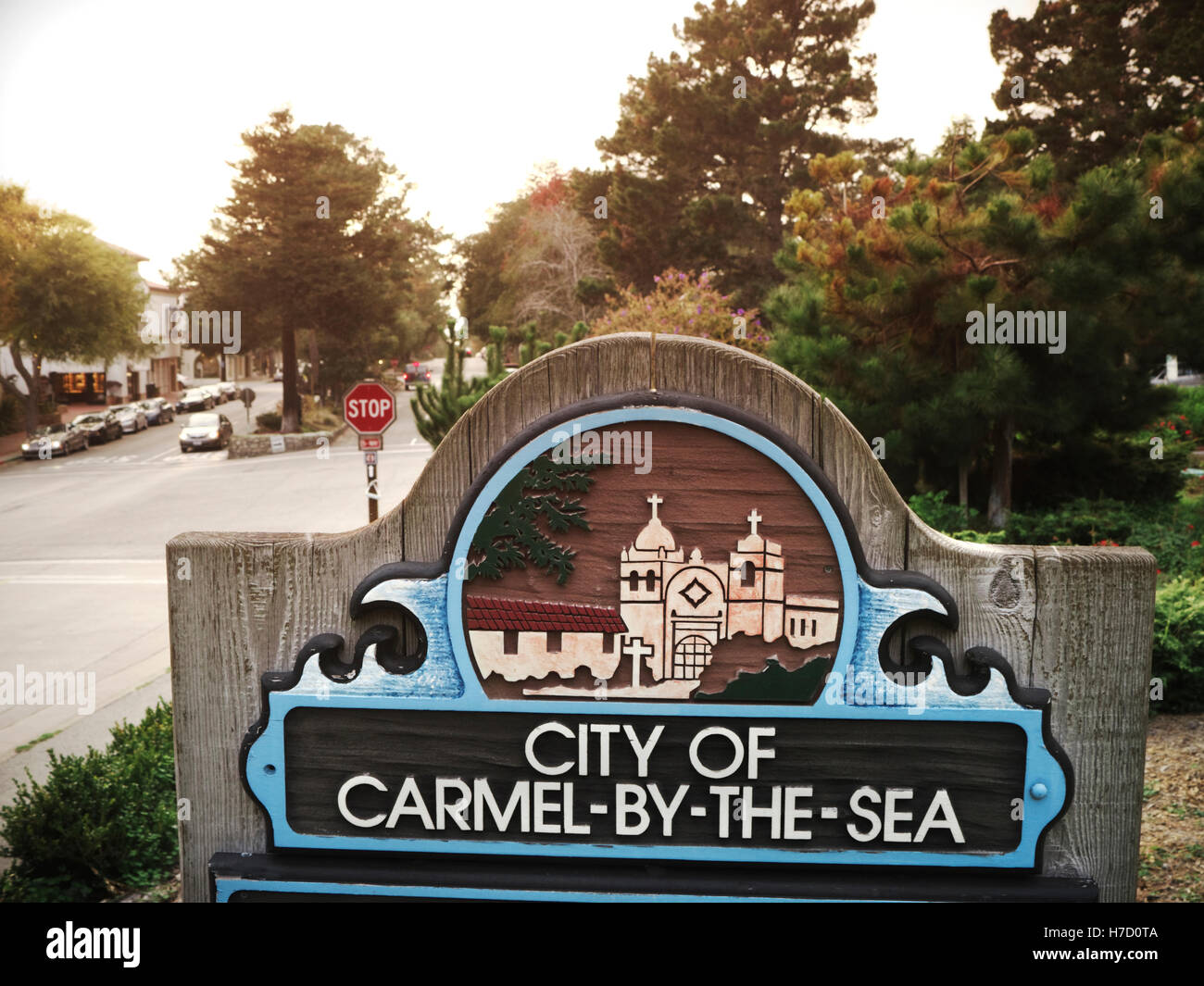 Vintage retro look on City limits sign with Carmel Mission engraving at entrance to Carmel by the sea California - Stock Image