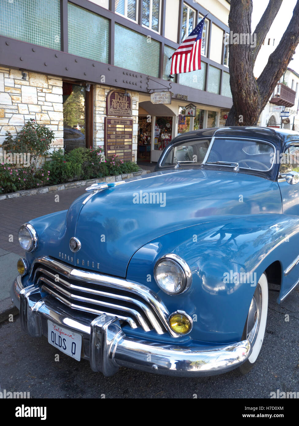 1940's Vintage Oldsmobile Dynamic 66 Club Coupe 4L 1948 two door coupe parked in Ocean Avenue Carmel Monterey - Stock Image