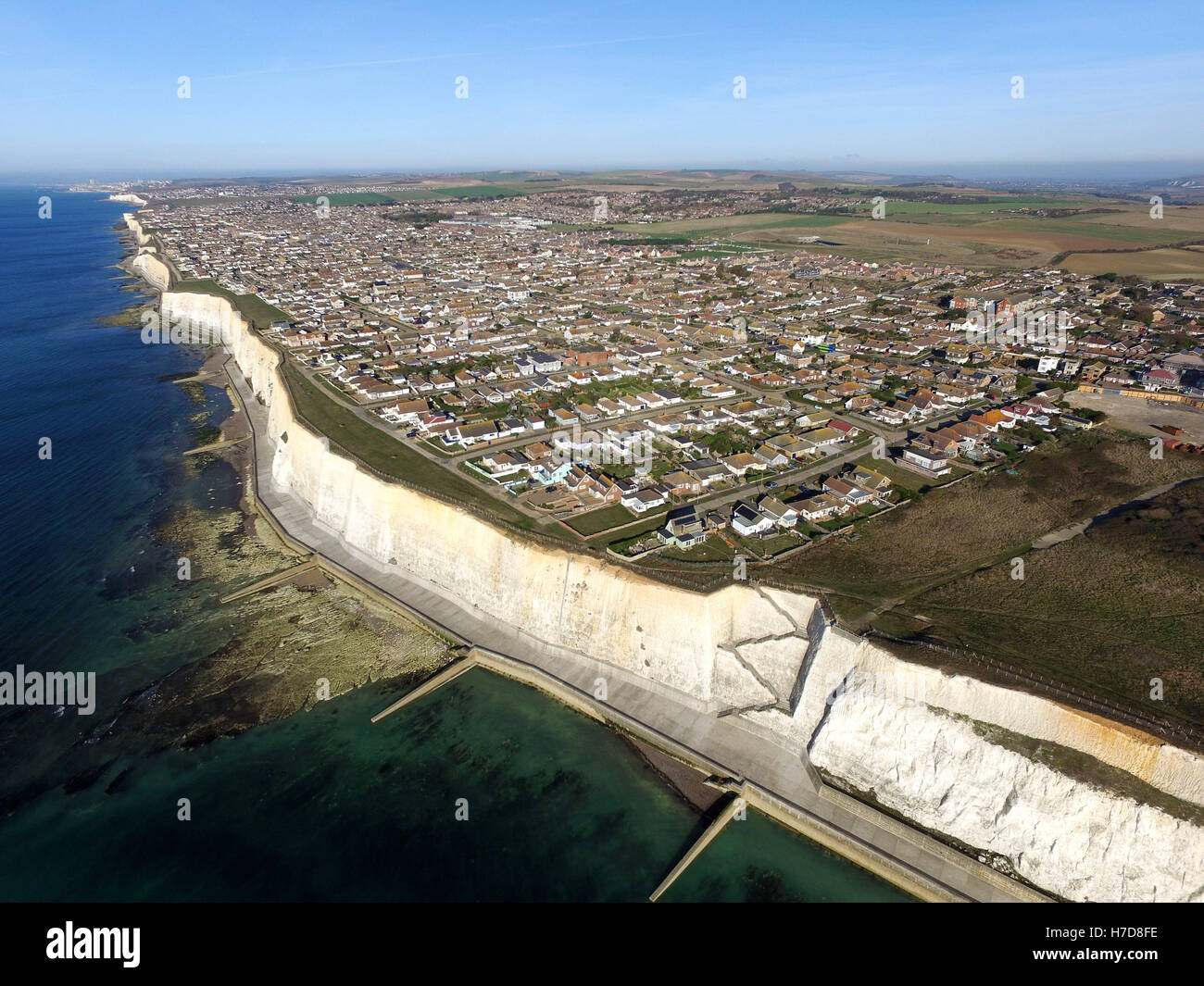 Aerial view of Peacehaven, East Sussex, a small seaside town perched on top of chalk cliffs near the South Downs - Stock Image