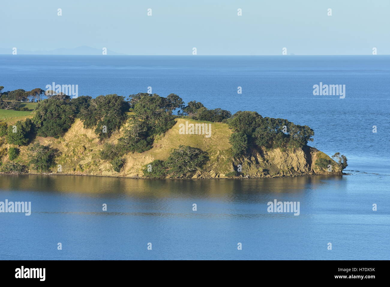 View of calm waters of Hauraki Gulf outside Mahurangi Harbour. - Stock Image