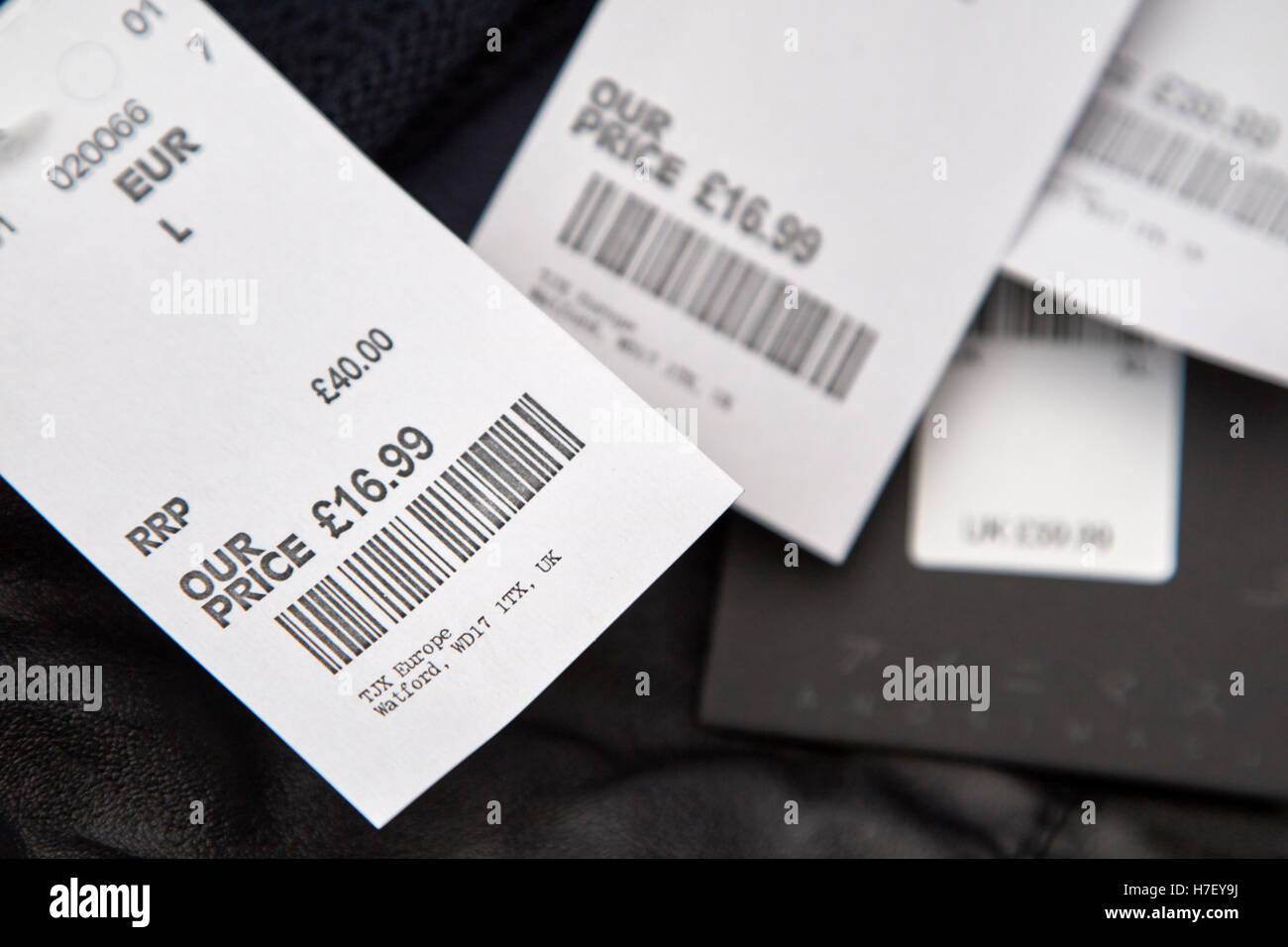 tkmax reduced price tags on mens clothing Stock Photo