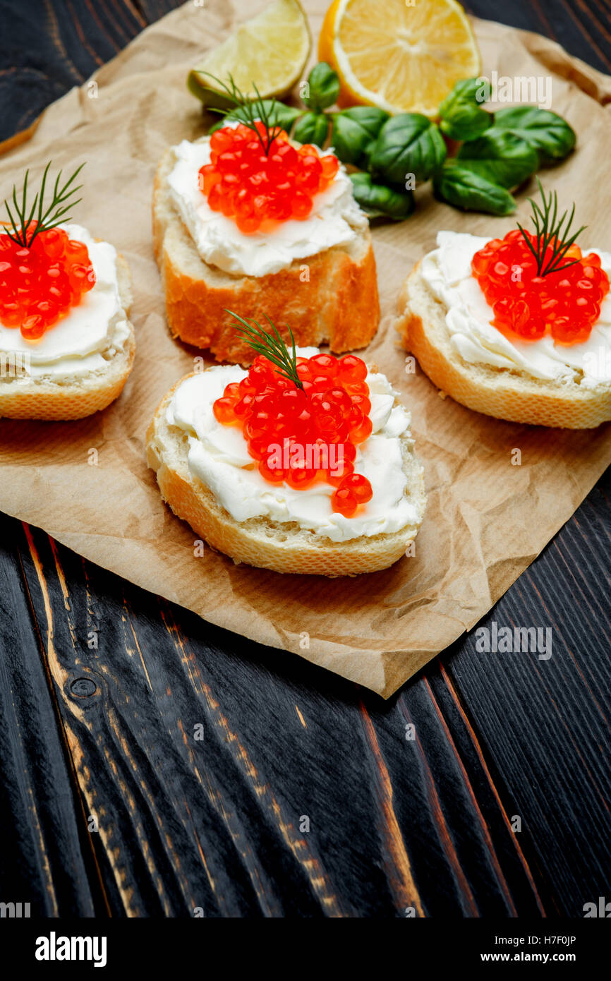 Canapes with red caviar - Stock Image