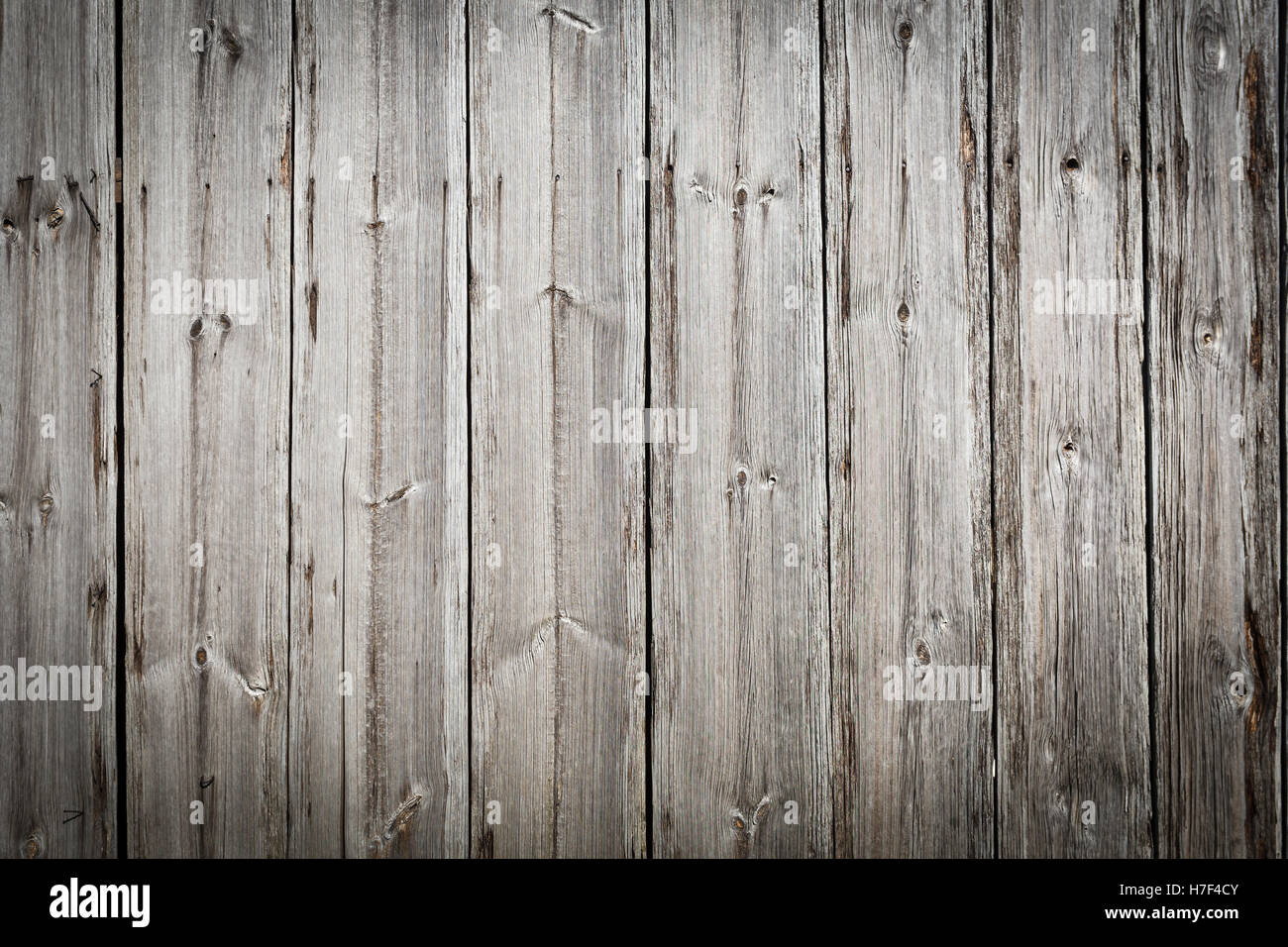 Wooden boards, grey color background, vertical lines, horizontal orientation,vignette - Stock Image