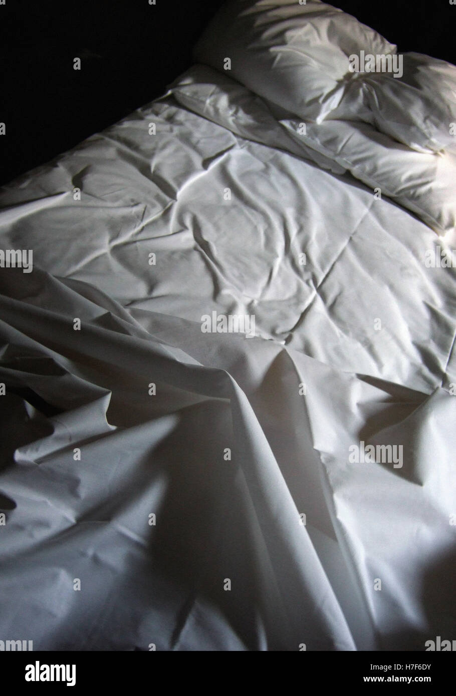 slept in unmade bed - Stock Image