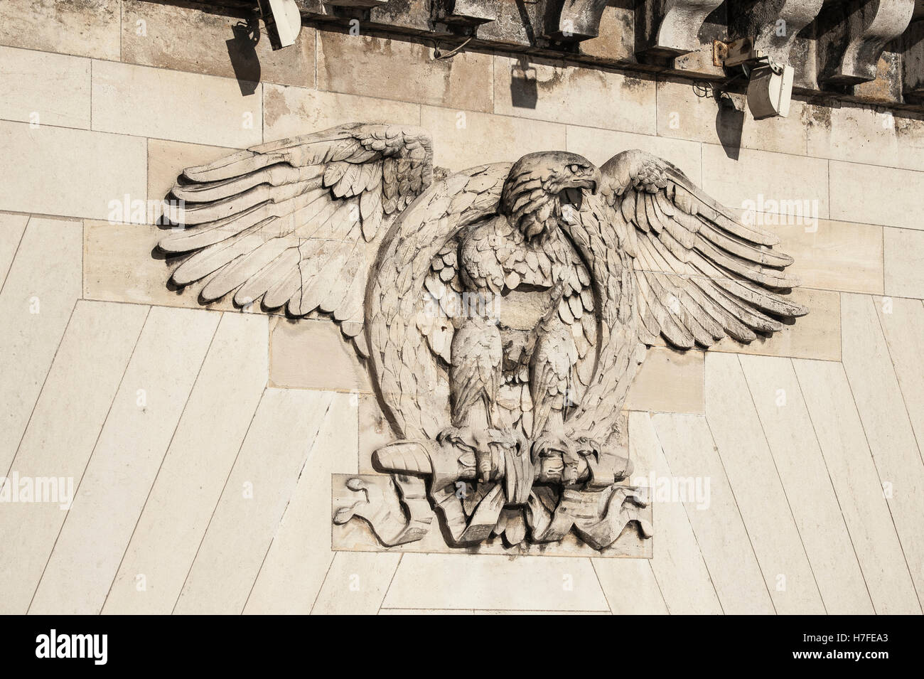 Heraldic animal eagle with a laurel wreath, relief on bridge, Pont Neuf, Paris, France - Stock Image