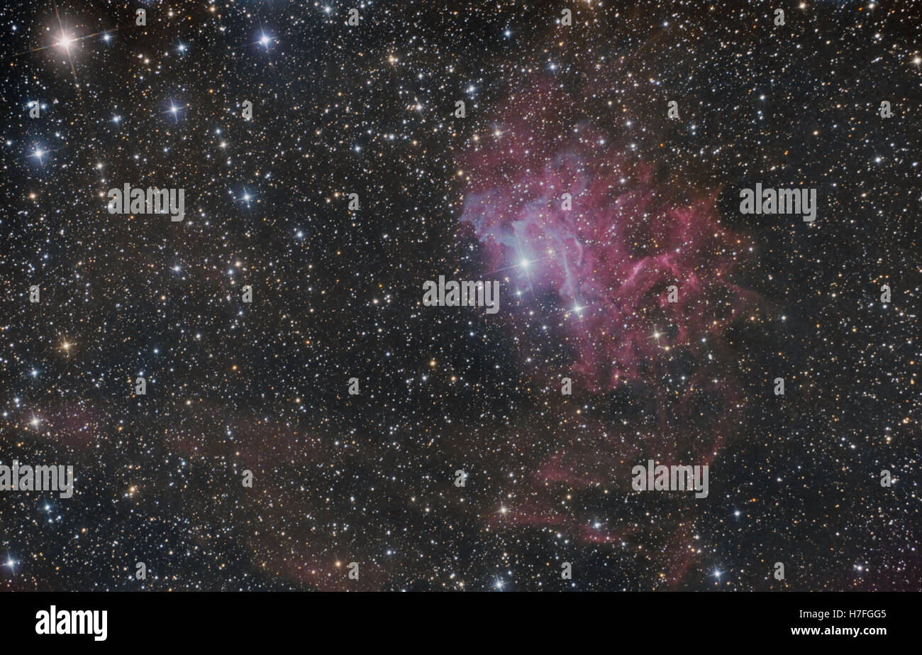 Flaming star nebula (IC 405), imaged with a telescope and CMOS camera - Stock Image