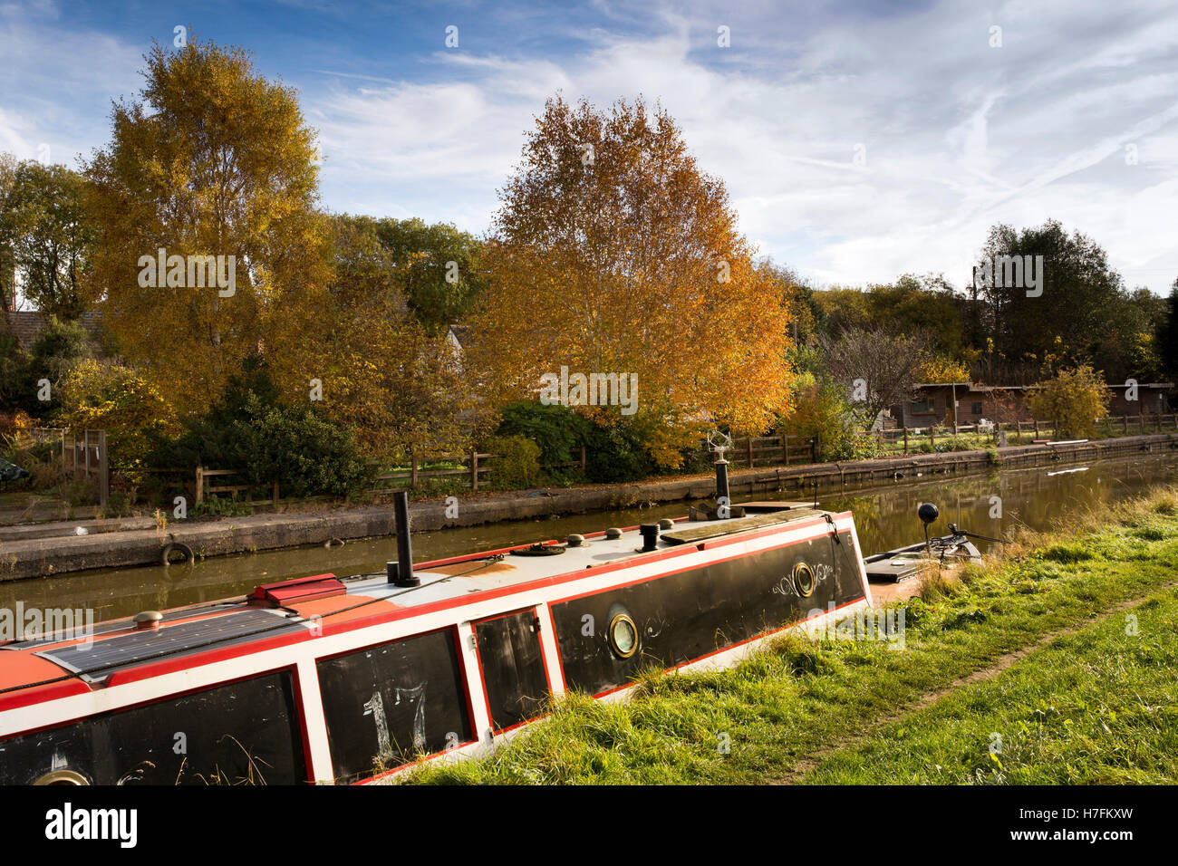 UK, England, Cheshire, Sandbach, Moston, Trent and Mersey Canal, autumn, narrowboat moored on towpath - Stock Image