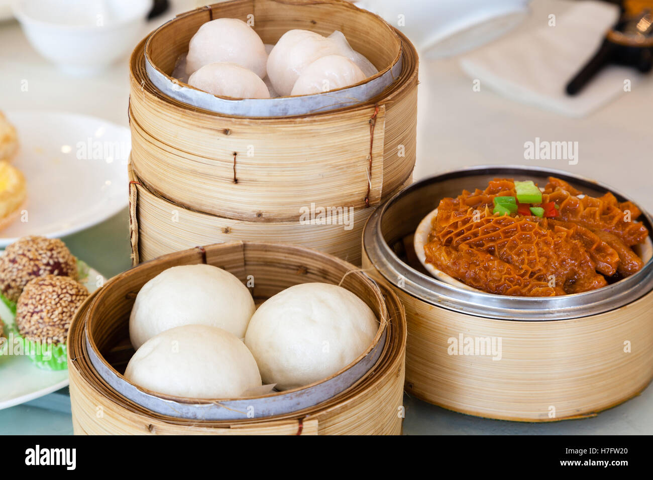 steamed chinese dim sum served in bamboo steamers including buns