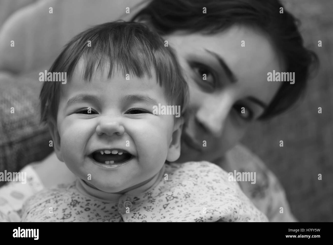 kid smile mother small - Stock Image