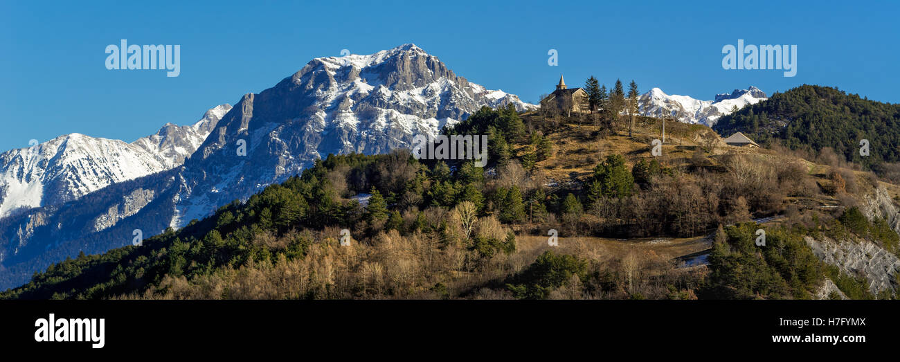 Montgardin village church and Pic Morgon (Grand Morgon) in Winter, Southern French Alps, France - Stock Image