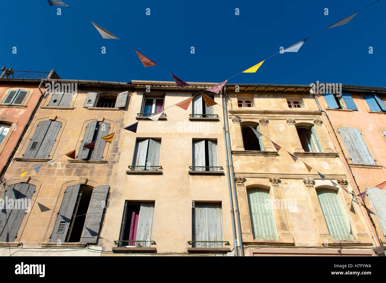 Traditional Provence homes in the town centre of Tarascon, featuring pastel-couloured window shields, France, - Stock Image