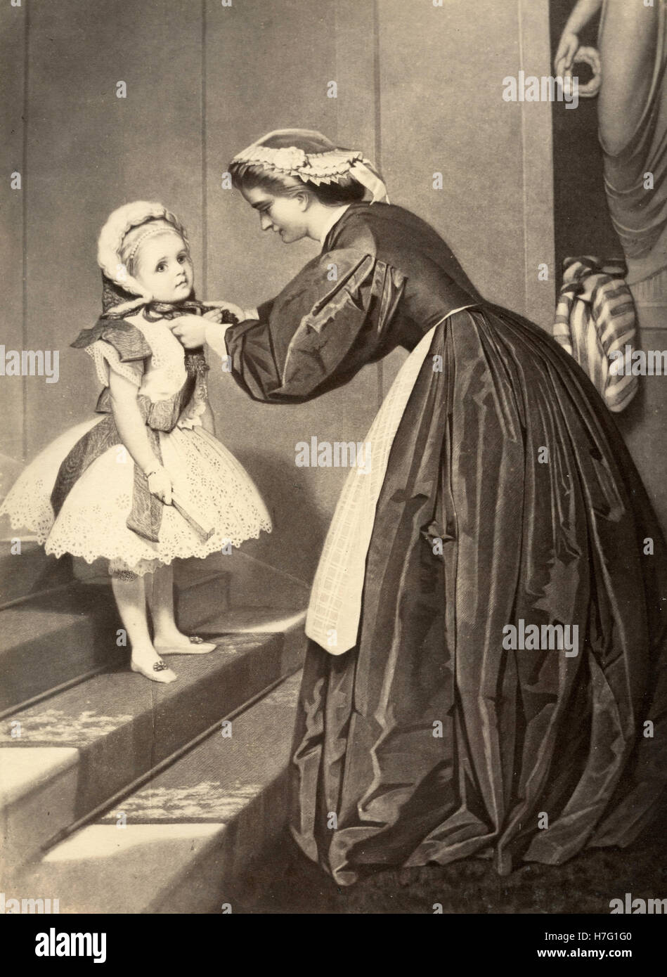Dressing the little girl, etching - Stock Image