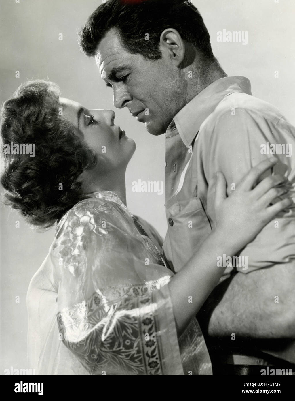 Actors Robert Ryan and Barbara Stanwyck in the movie Escape to Burma, USA 1955 - Stock Image