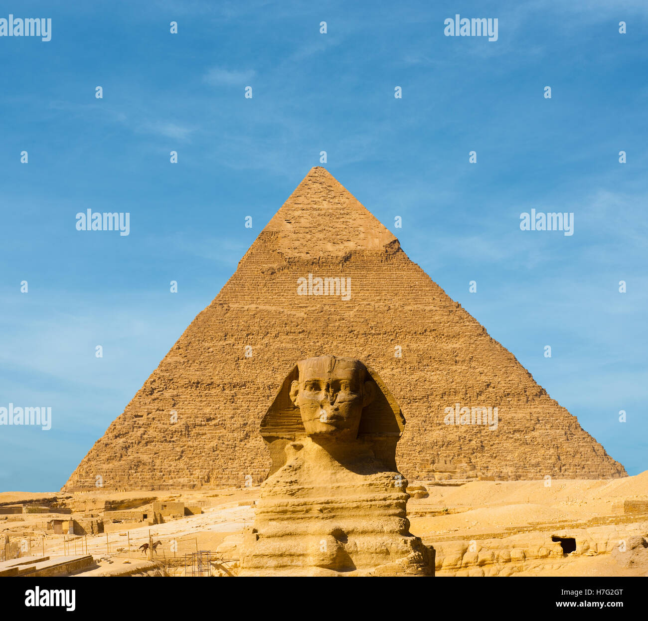 The Great Sphinx face forward centered in front of the largest Egyptian Pyramid of Khafre in Giza, Cairo, Egypt - Stock Image