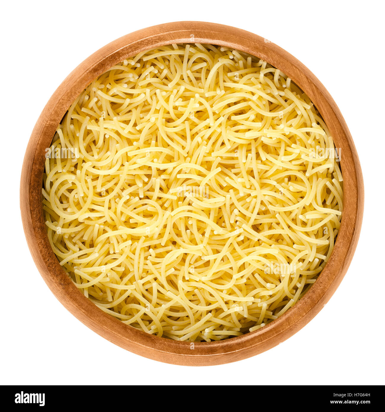 Filini short cut pasta in wooden bowl. Italian miniature noodles with little threads, prepared with eggs. - Stock Image