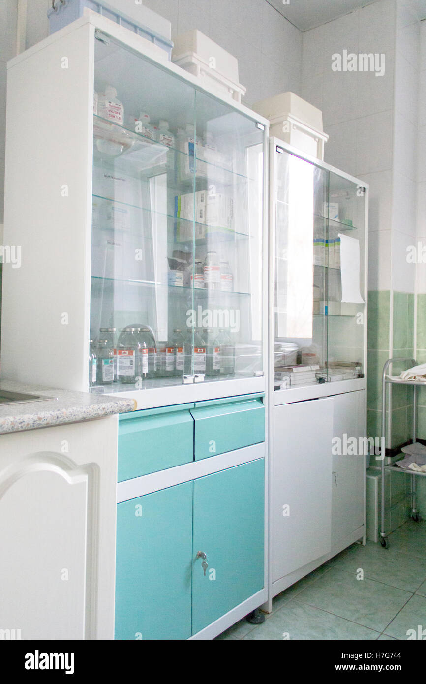 Photo of white closet with medical attribute - Stock Image