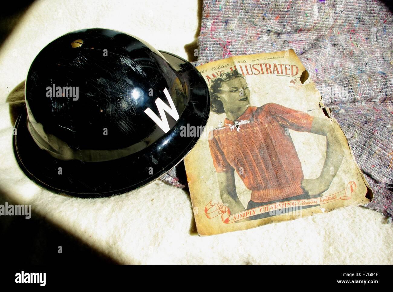 ARP (air raid precaution) wardens helmet  in Henderson's shelter - Stock Image