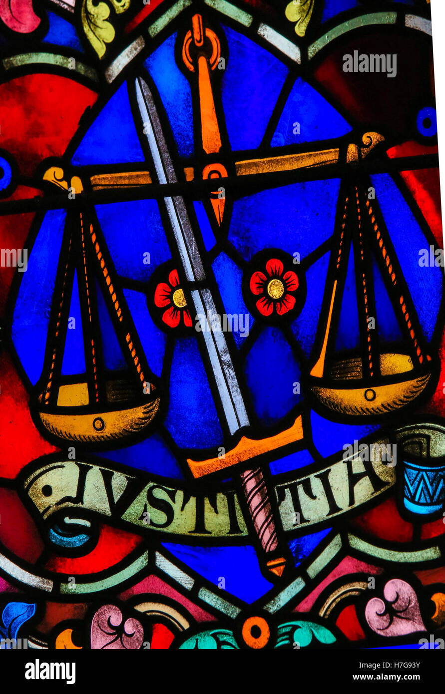 Stained Glass window representing Justice, symbolized by sword and balance, in the Cathedral of Saint Rumbold in - Stock Image