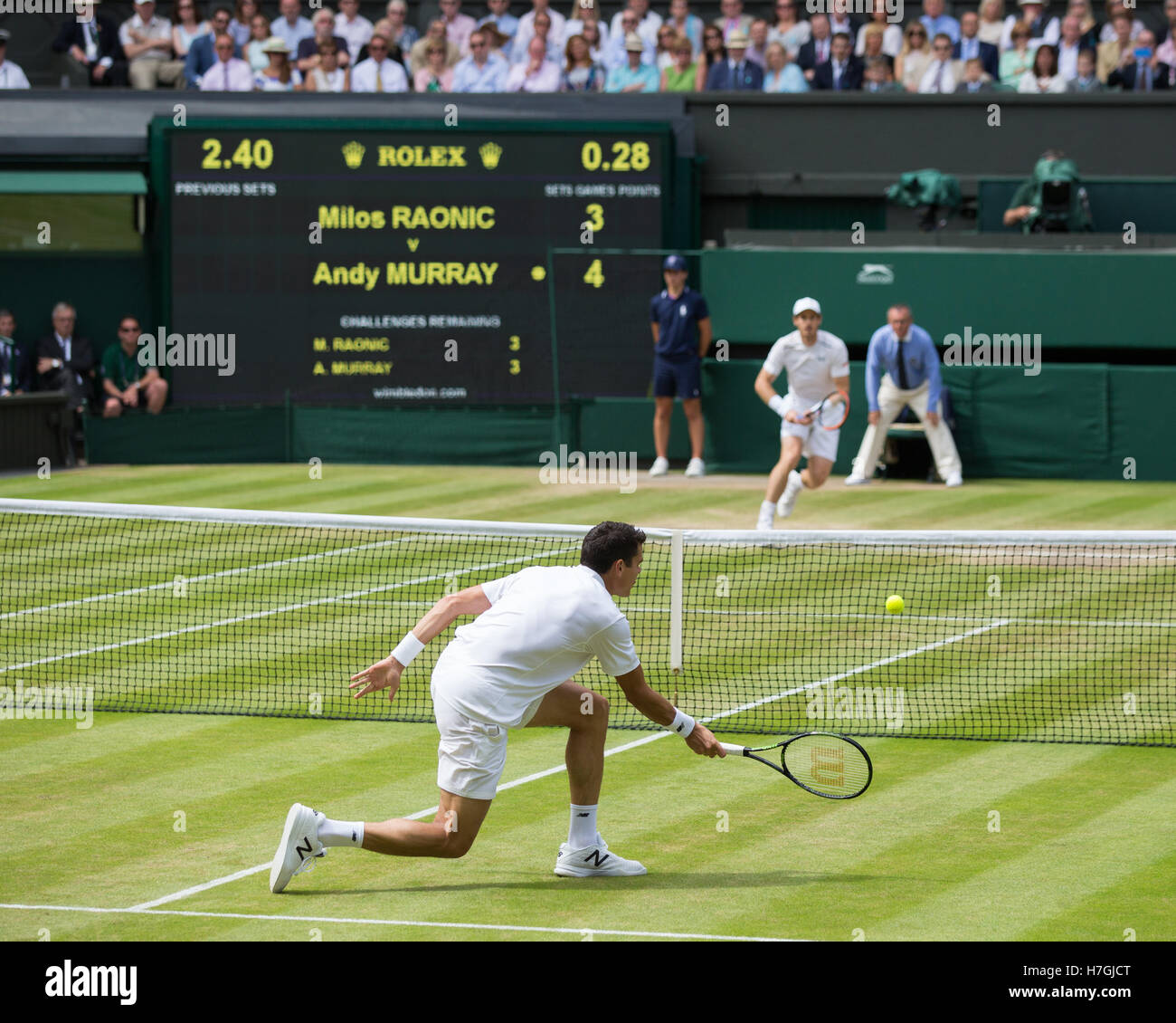 Milos Raonic (CAN) vs. Andy Murray (GBR) , action at Wimbledon 2016 final. Stock Photo