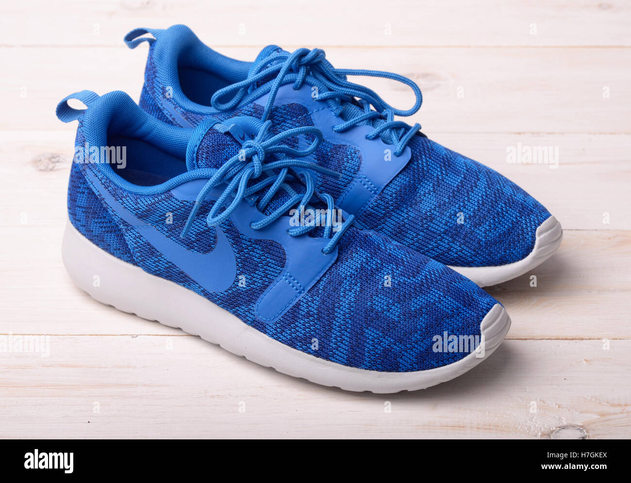 SAMARA, RUSSIA - August 28, 2016: Blue Nike sneakers for running, football, training, showing the Nike logo, illustrative - Stock Image