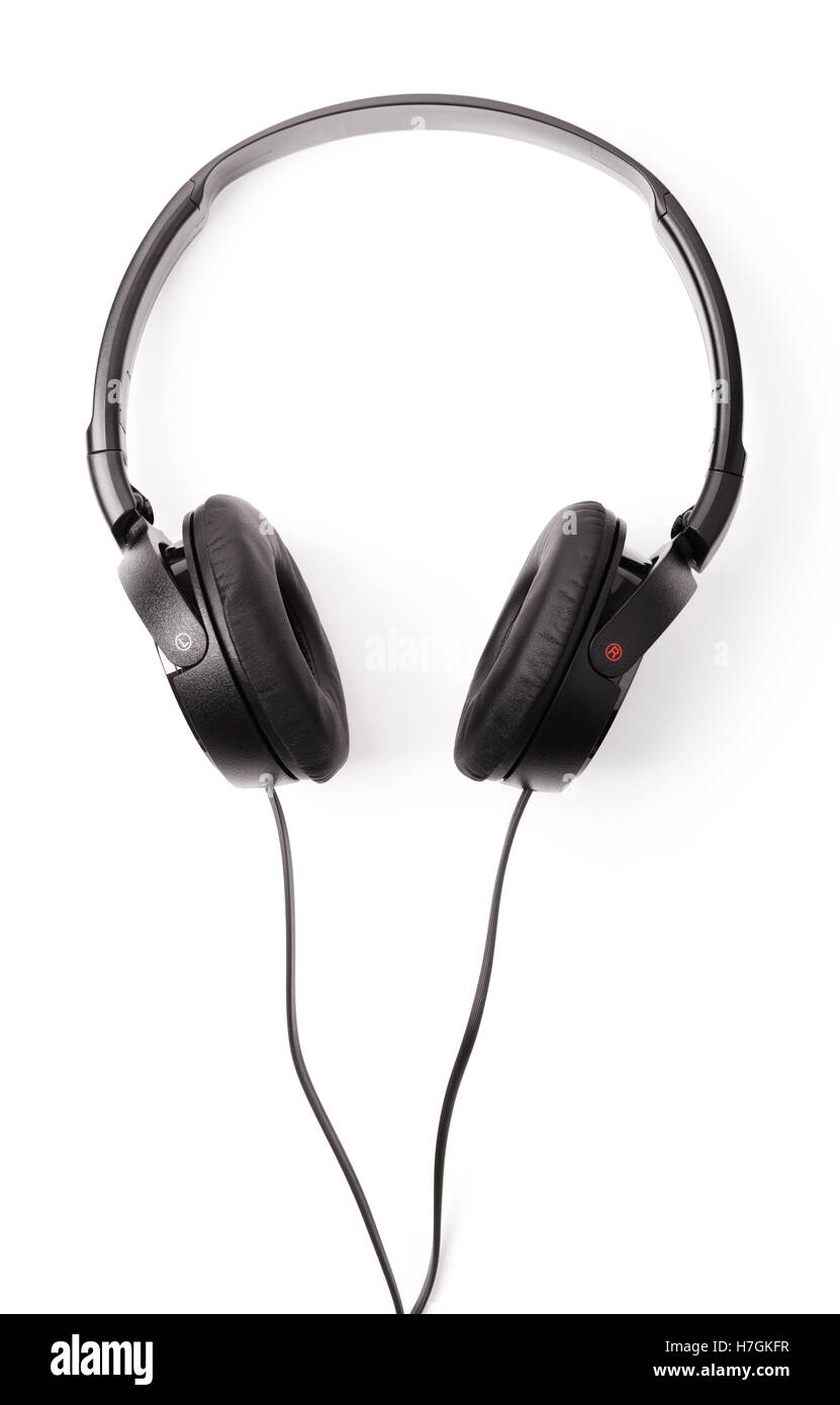 Black headphones with wires isolated on white background - Stock Image