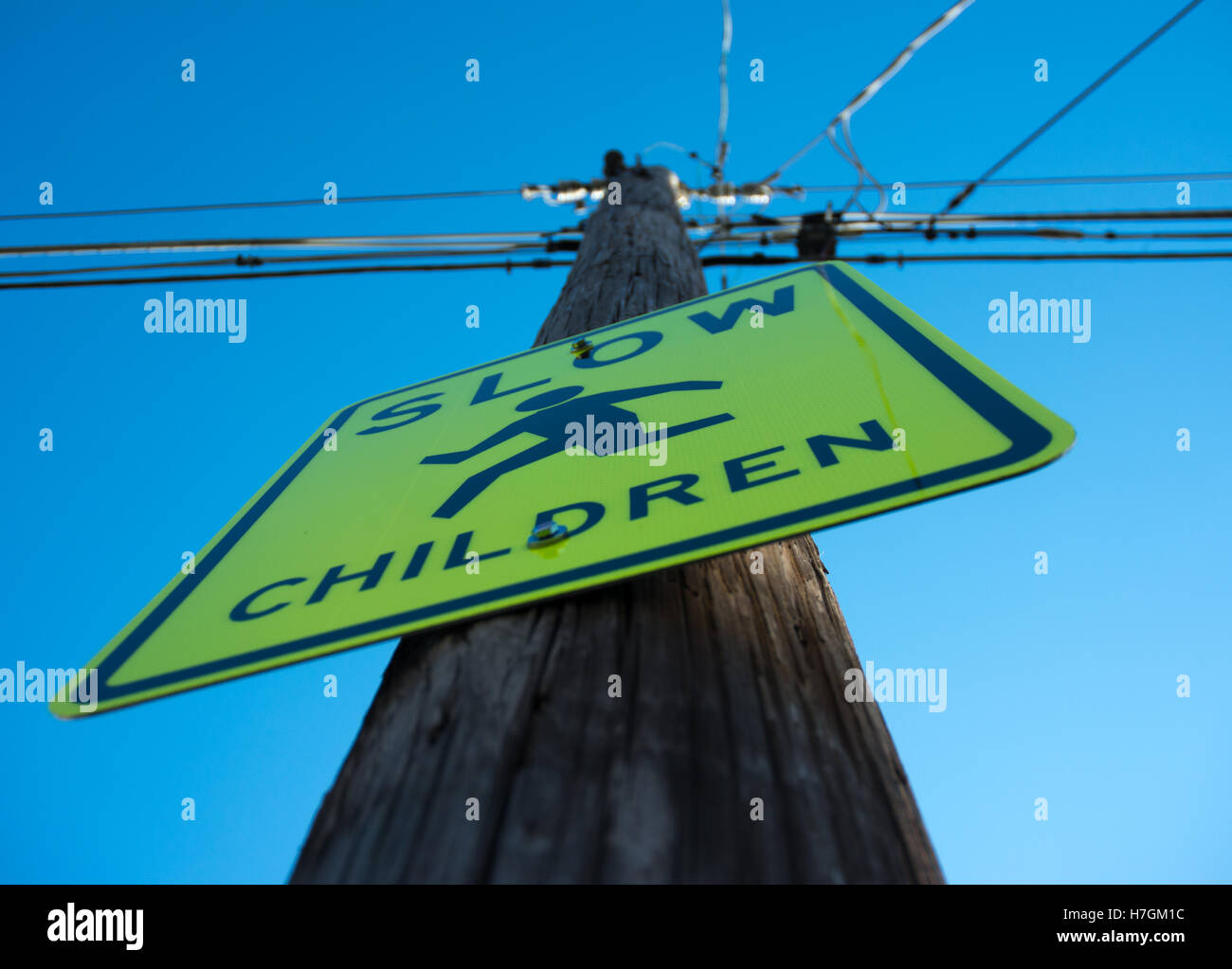Electrical poll with a sign on it - Stock Image