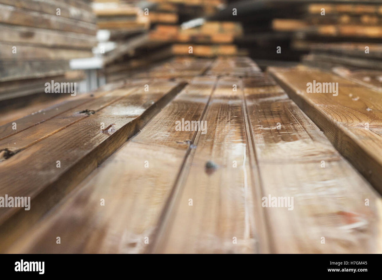 colorful wooden wet planks  which lie on one another on the background - Stock Image