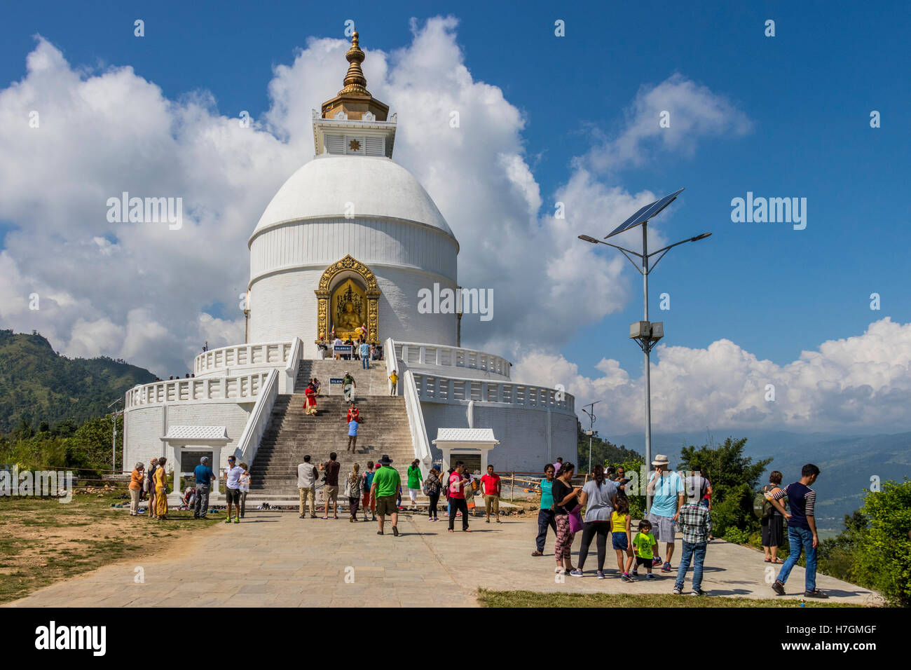 Locals and tourist visiting the World Peace Pagoda Pokhara Nepal - Stock Image