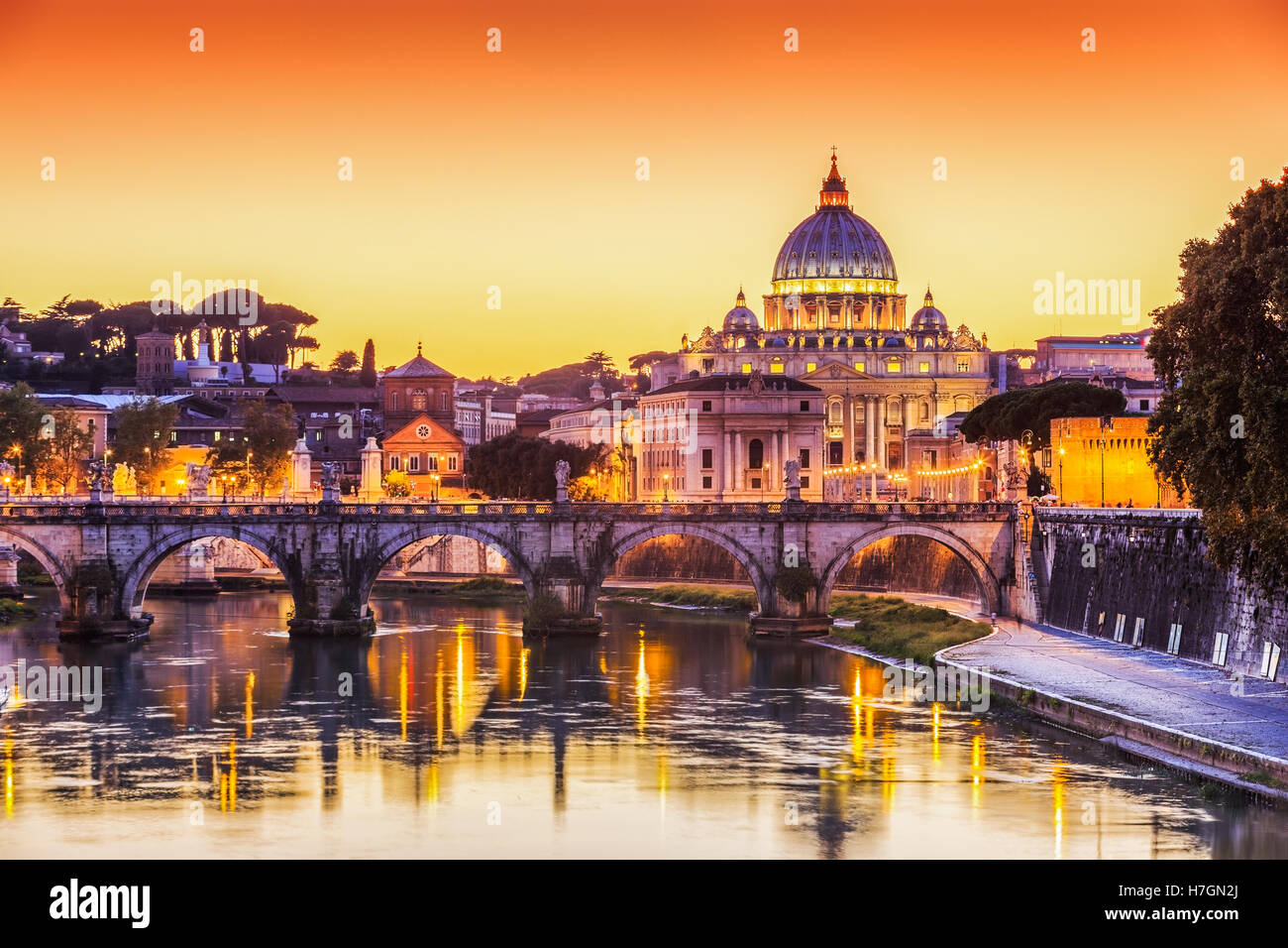 San Pietro Basilica and Ponte St Angelo at sunset. Rome, Italy - Stock Image